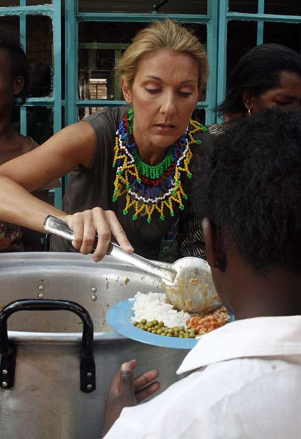 Celine Feeds the Babies in Soweto