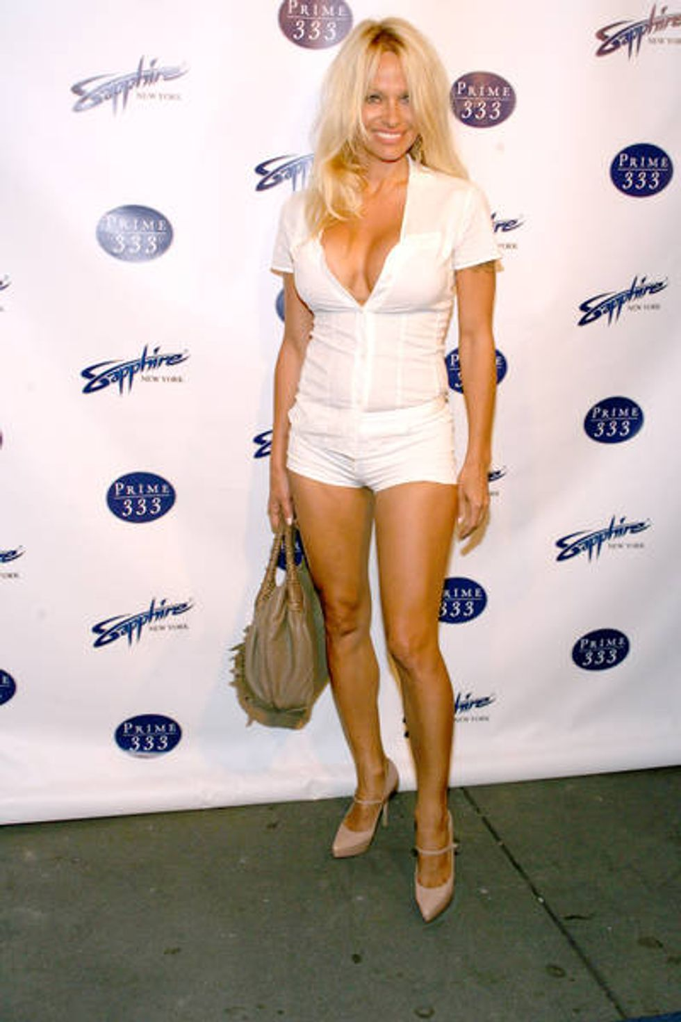 """Pamela Anderson Attends Sapphire Strip Club Opening, Even Though It's """"Not For Vegans"""""""