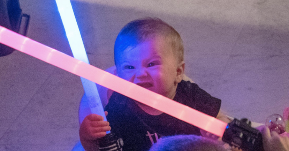 This Baby Made INSANE Faces Playing With Her Lightsaber, and Twitter Can't Get Enough
