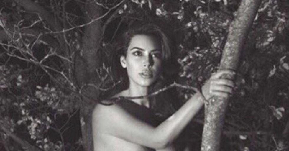 Kim Kardashian Is Posing in a Tree… Wearing Only Boots