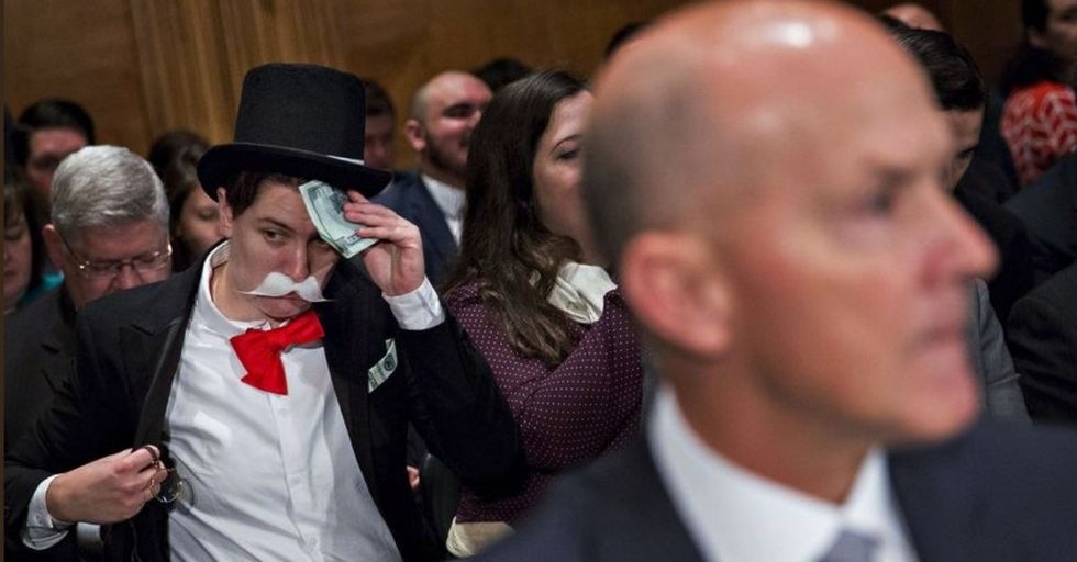 Someone Dressed as Rich Uncle Pennybags from 'Monopoly' Photobombed the Equifax Hearing — and It's Even Funnier Than You're Imagining