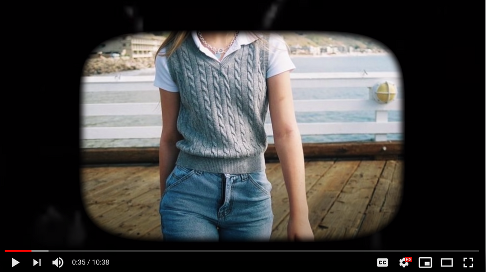 Girl wearing a sweater vest