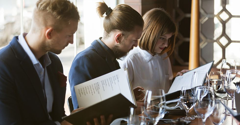 9 Psychological Tricks Restaurants Use on Their Menus to Get You to Spend More Money