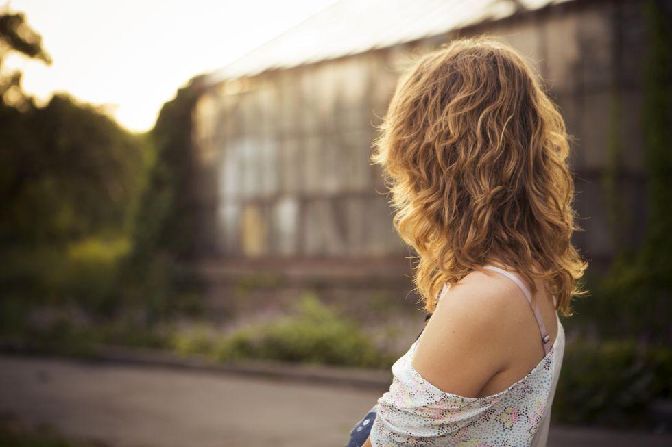 File:Woman looking at greenhouse (Unsplash).jpg - Wikimedia Commons