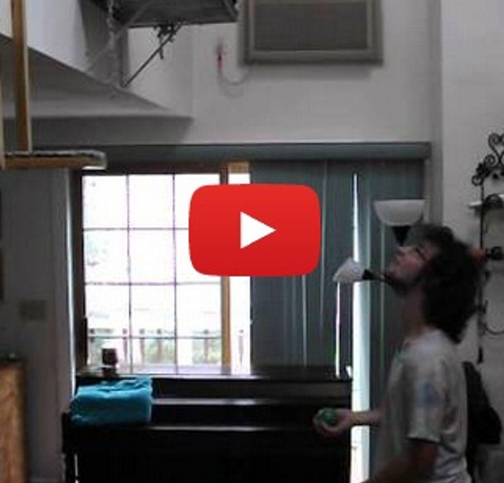 Man juggles balls that his cat bats back to him