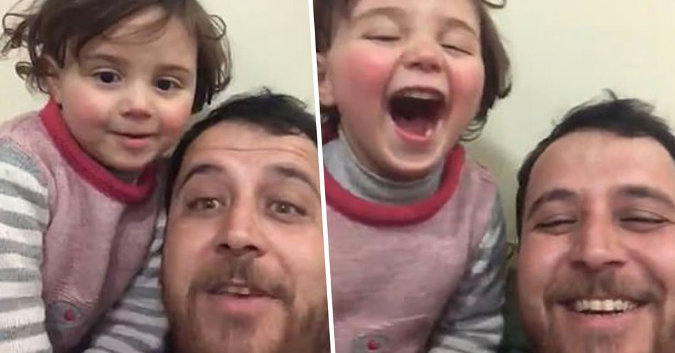 Syrian Father Teaches Daughter to Laugh at Sound of War Planes to Keep Her Spirits High