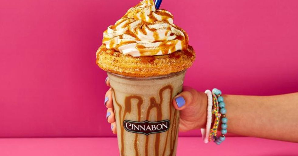 Cinnabon's New Churro Chillatta Is Topped With Whipped Cream and a Churro and It Looks Incredible