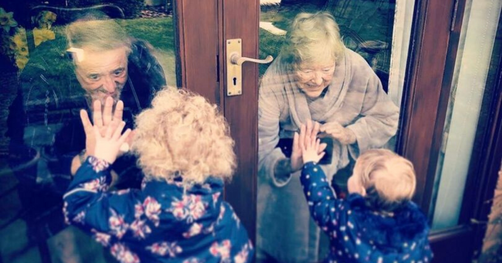 Grandparents Watch Grandkids Blow Kisses Through Windows While Stuck at Home