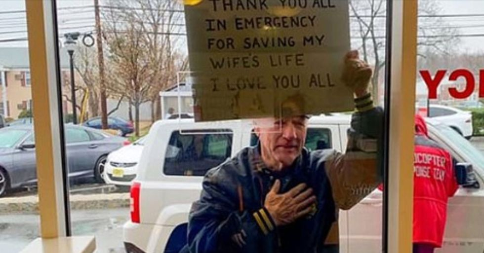 Man Holds up Sign Thanking Hospital Emergency Staff for Saving His Wife's Life