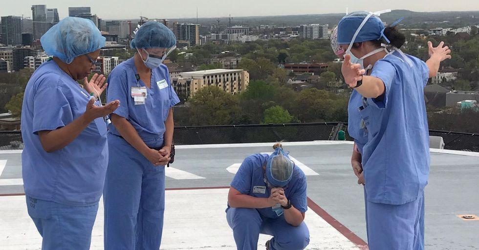 Moving Photo Shows Nurses Praying on Hospital Roof Amid Pandemic
