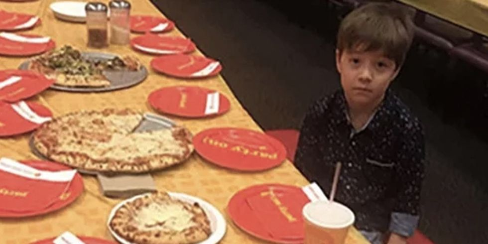 6-Year-Old Pictured Eating Alone After Nobody Turned Up To His Birthday Party