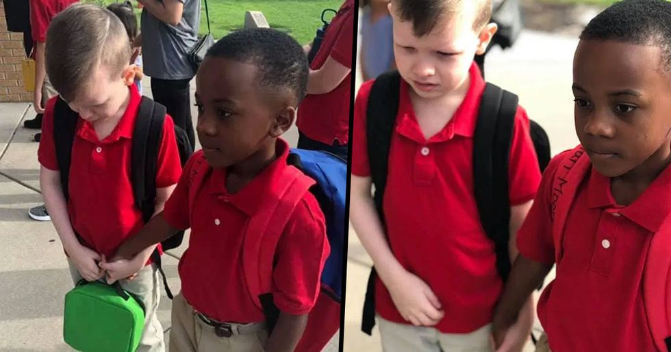 Young Boy Holds Crying Autistic Classmate's Hand on Their First Day of School