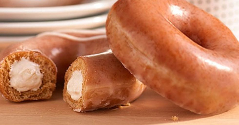 Krispy Kreme Is Selling Pumpkin Spice Donuts Stuffed with Cheesecake and They Look Incredible