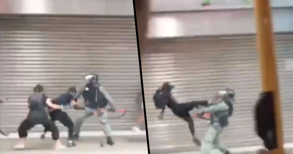 Hong Kong Protester Flying Kicks Policeman to Stop Him Arresting Another Protester
