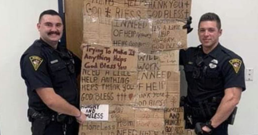 Two Police Officers Posed With Signs Taken From Homeless People and Called It a 'Homeless Quilt'