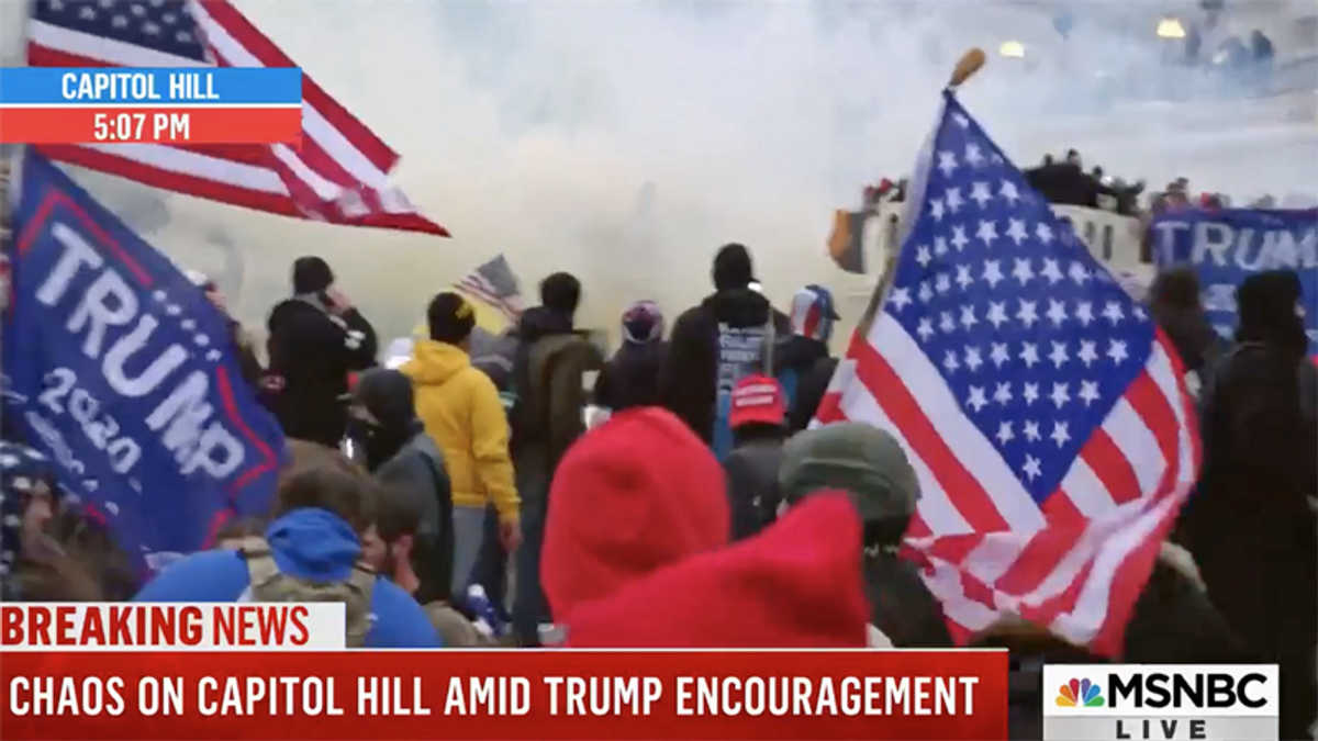 WATCH: Police unleash tear gas and flash-bang grenades to clear Capitol of Trump insurrectionists