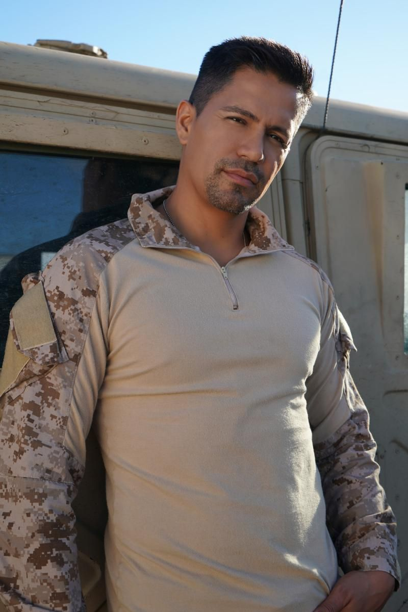 Magnum in a military combat shirt with camouflage sleeves