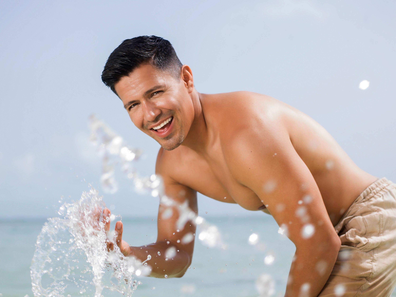 Jay Hernandez splashing around on the beach