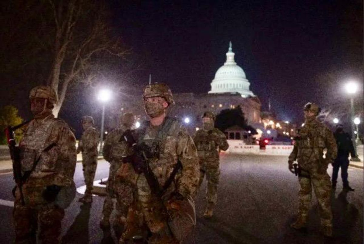 Troops on Washington streets to begin carrying arms