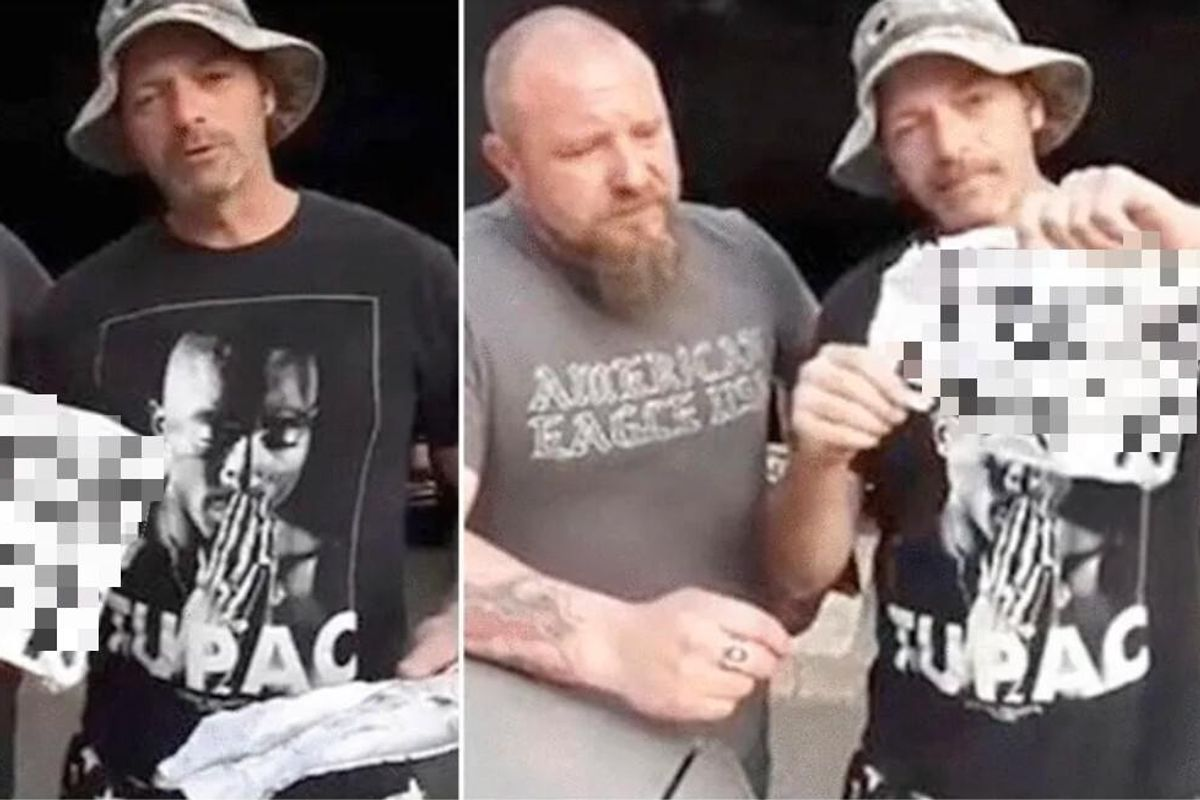 These two white 'working guys' holding racist signs is not at all what you're expecting