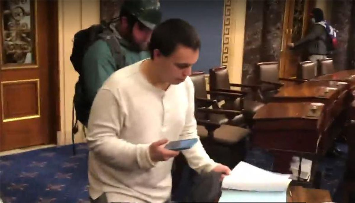 WATCH: Pro-Trump insurrectionists caught copying documents after storming Capitol floor