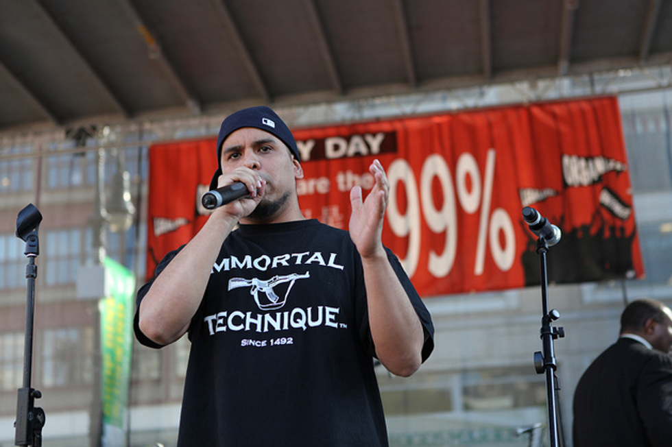 """Das Racist, Tom Morello, Dan Deacon, JD Samson and the """"Guitarmy"""" Perform at Occupy Wall Street on May Day"""