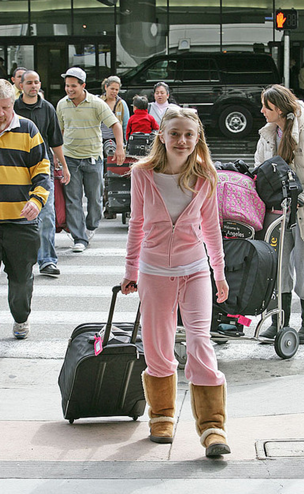 Celebrities in Pink Tracksuits: A Photographic History