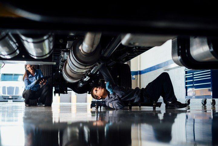 maintenance technician under truck
