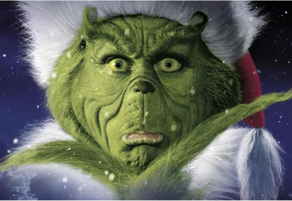 The Very True Story Of How 'The Grinch' Movie Made Me Throw Up On A Plane