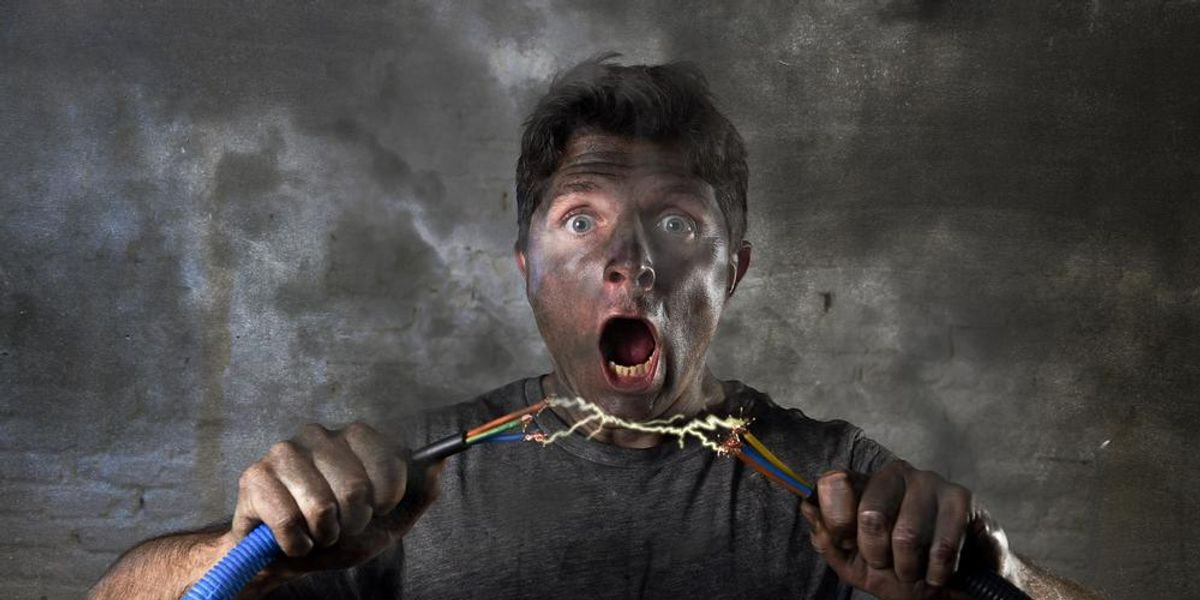 Young untrained man being electrocuted by cables.