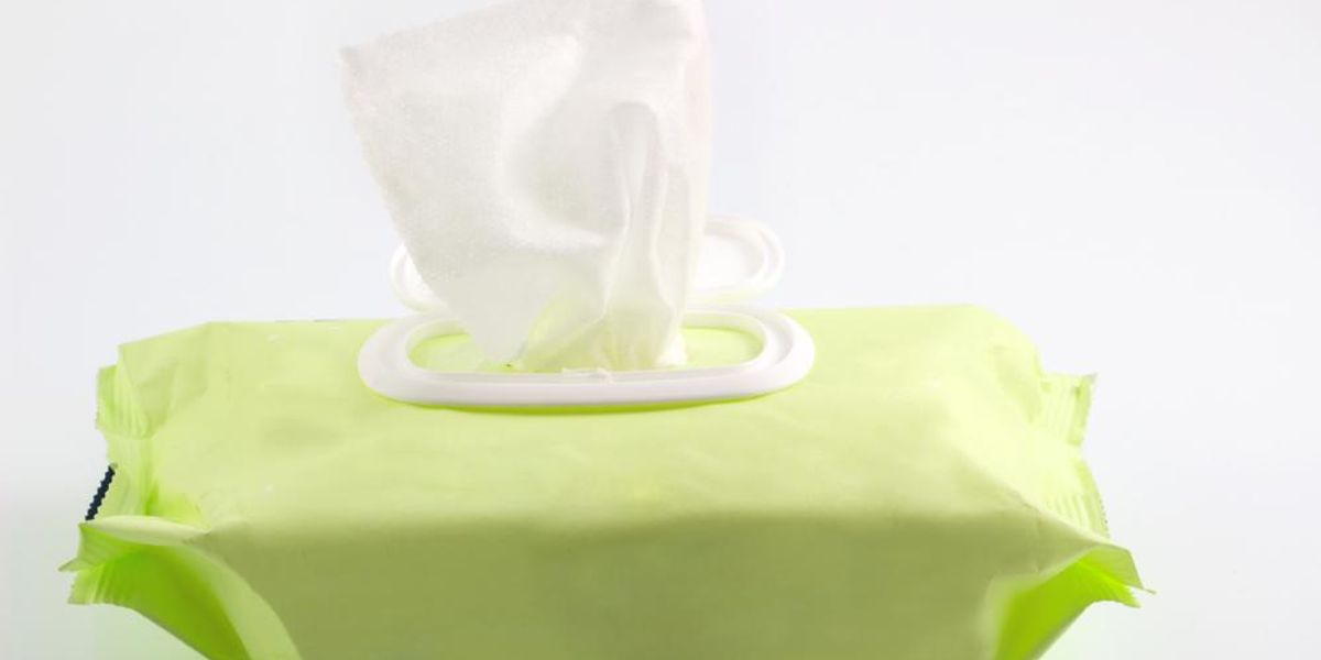 Disinfectant wipes packet on a white background.