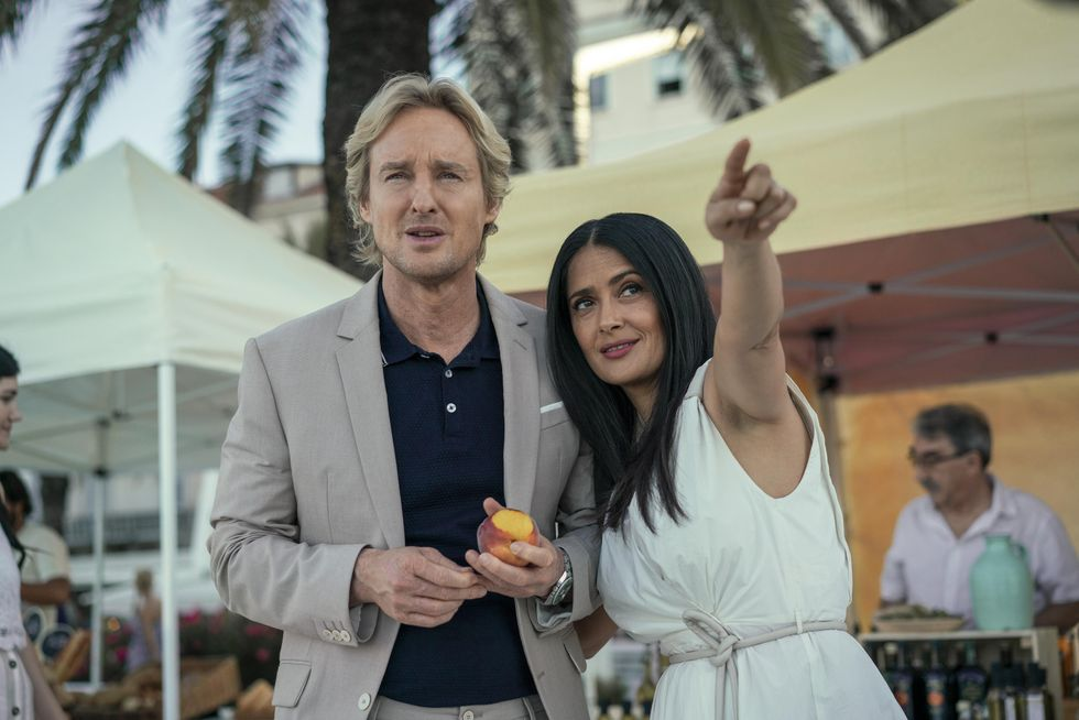 """Owen Wilson, who plays Greg, stands left of Salma Hayek, who plays Isabel in sci-fi drama """"Bliss."""""""