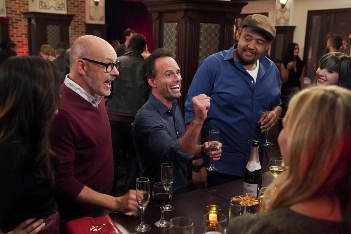 \u200bWalton Goggins as Wade with Rob Corddry as Forrest and Omar Miller as Ben at a singles bar