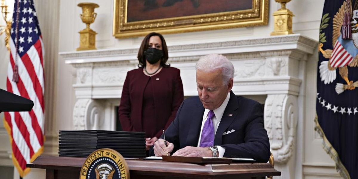 Biden signs `wartime` COVID-19 executive orders, imposing national...