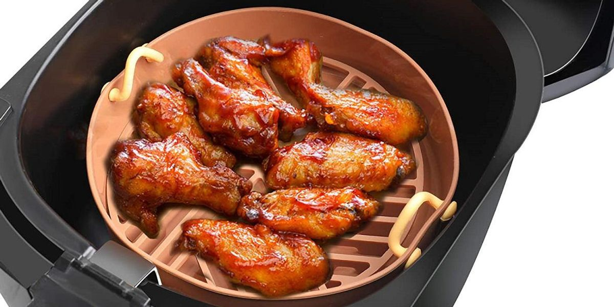 an air fryer basket with chicken wings