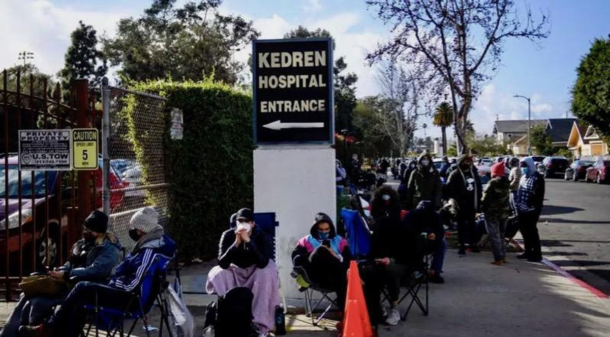 Los Angeles 'vaccine chasers' wait hours in hope of leftover doses