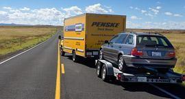 Penske Truck carrying a car