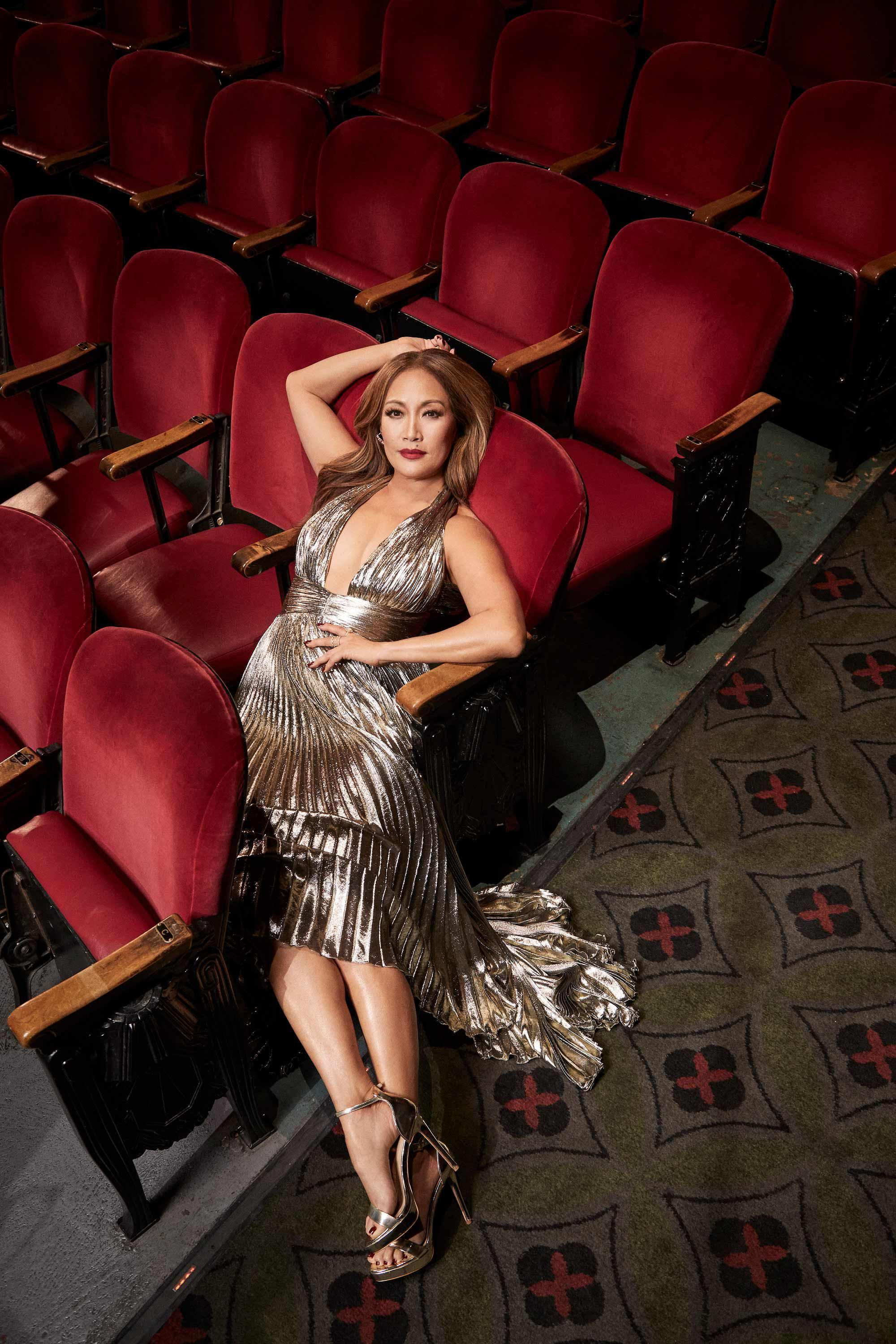 \u200bCarrie Ann Inaba models a metallic gown and matching shoes
