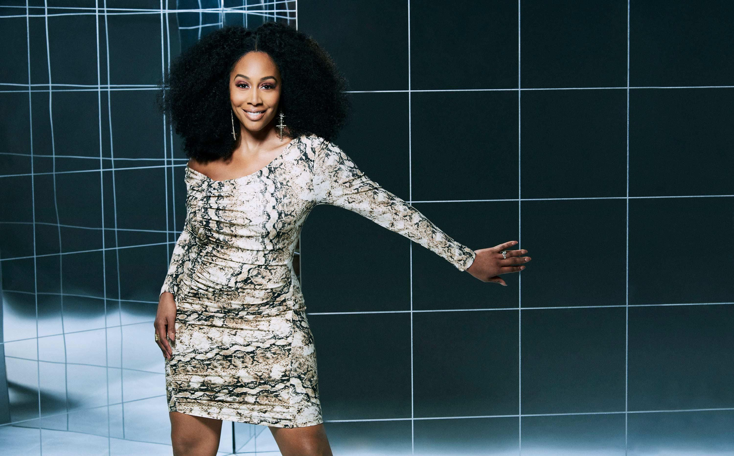 Simone Missick poses in a snakeskin-inspired mini dress