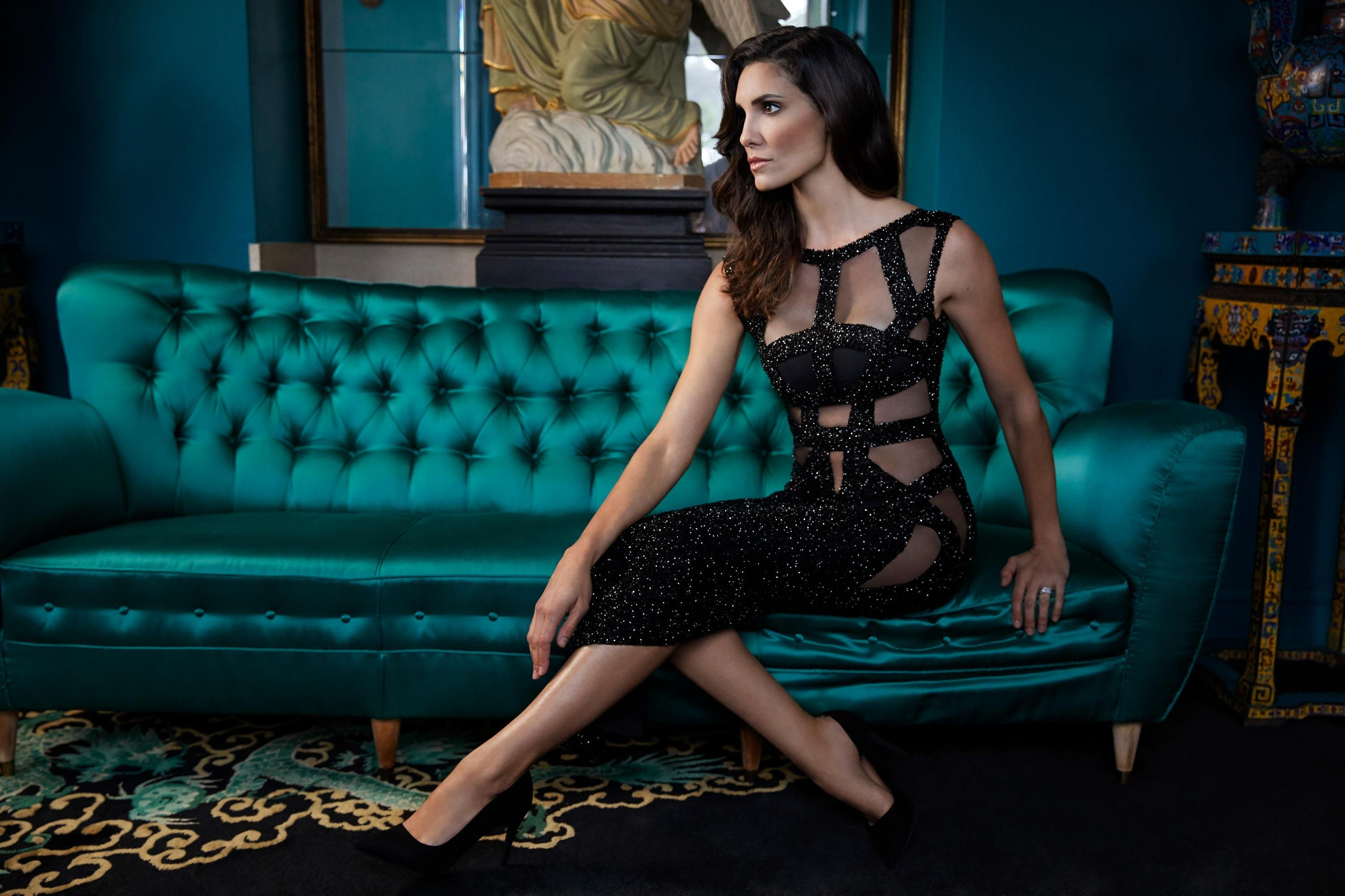 \u200bDaniela Ruah in a black dress with sheer peekaboo cutouts