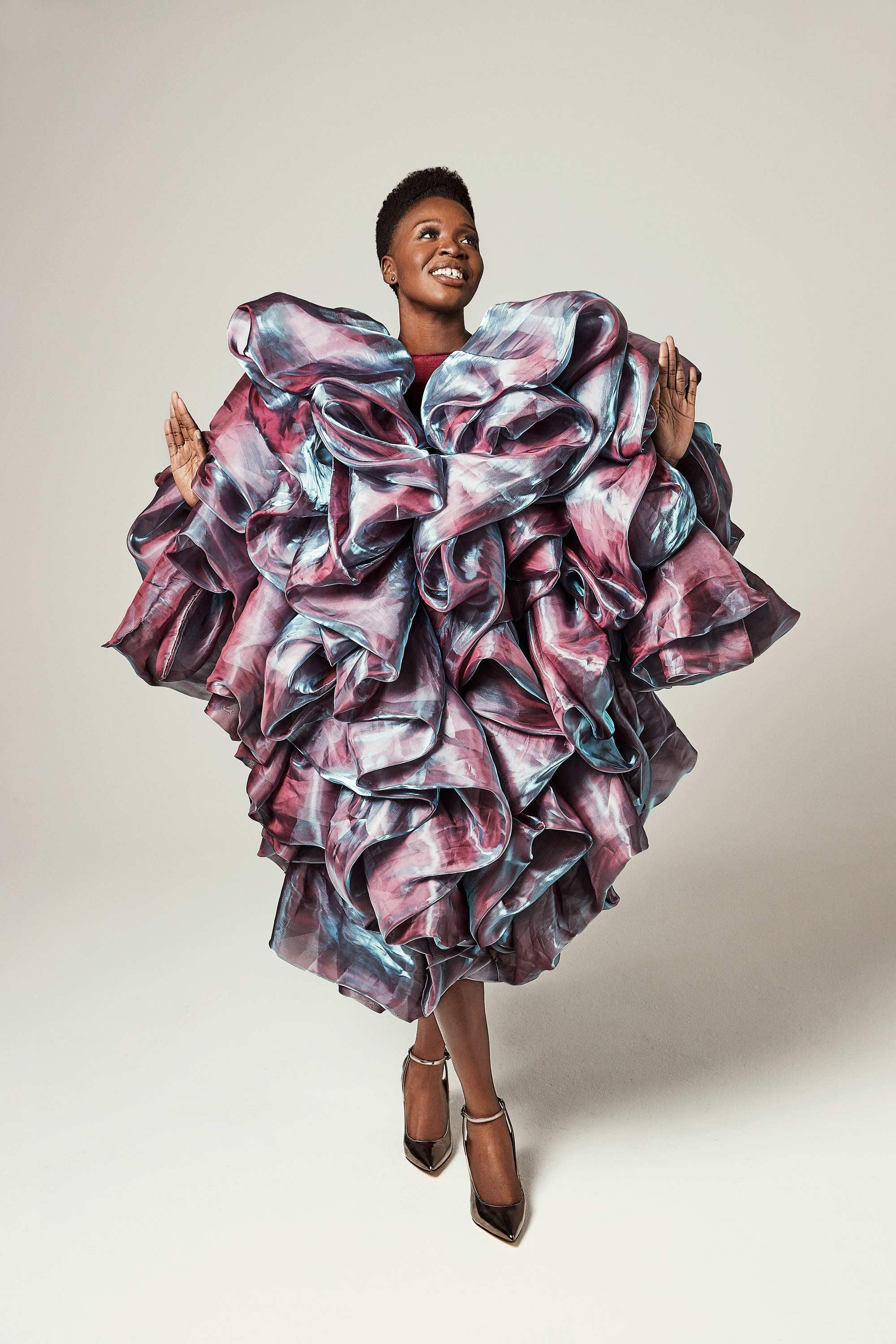 Folake Olowofoyeku in a lavishly ruffled iridescent dress