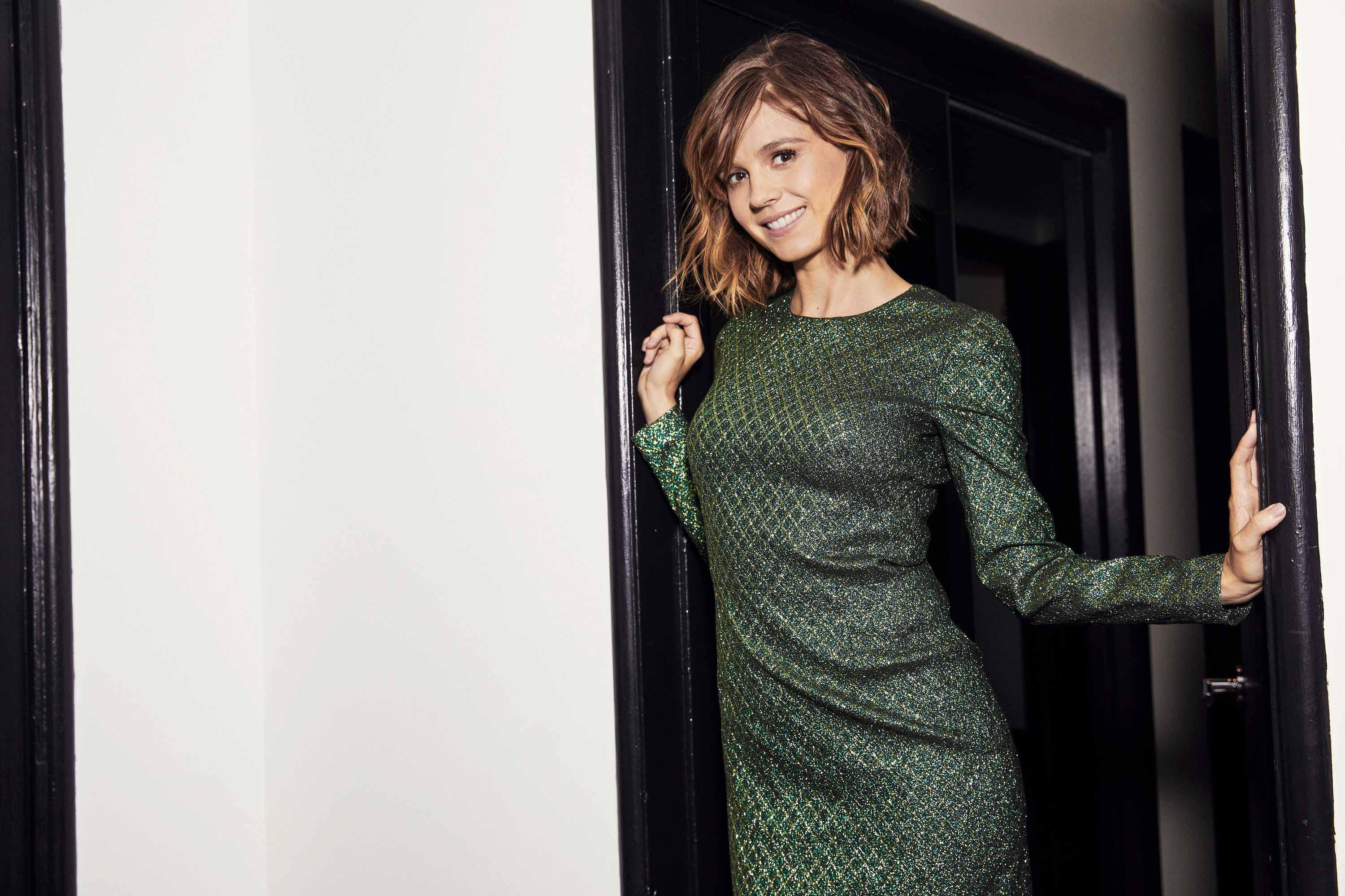 Katja Herbers in a metallic green dress with a diamond pattern