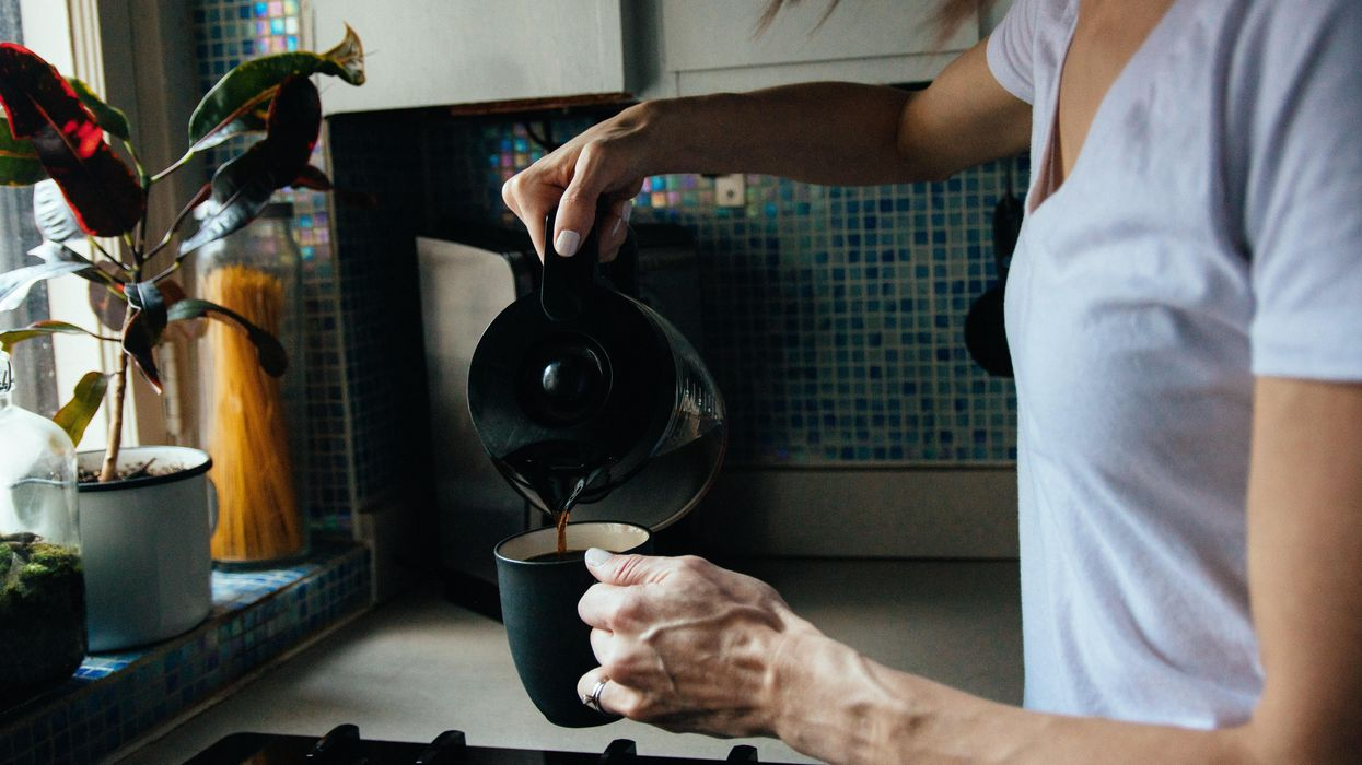 A woman pouring coffee, illustrating an article on routines.