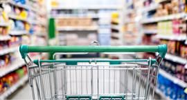 Shopping cart in store aisle