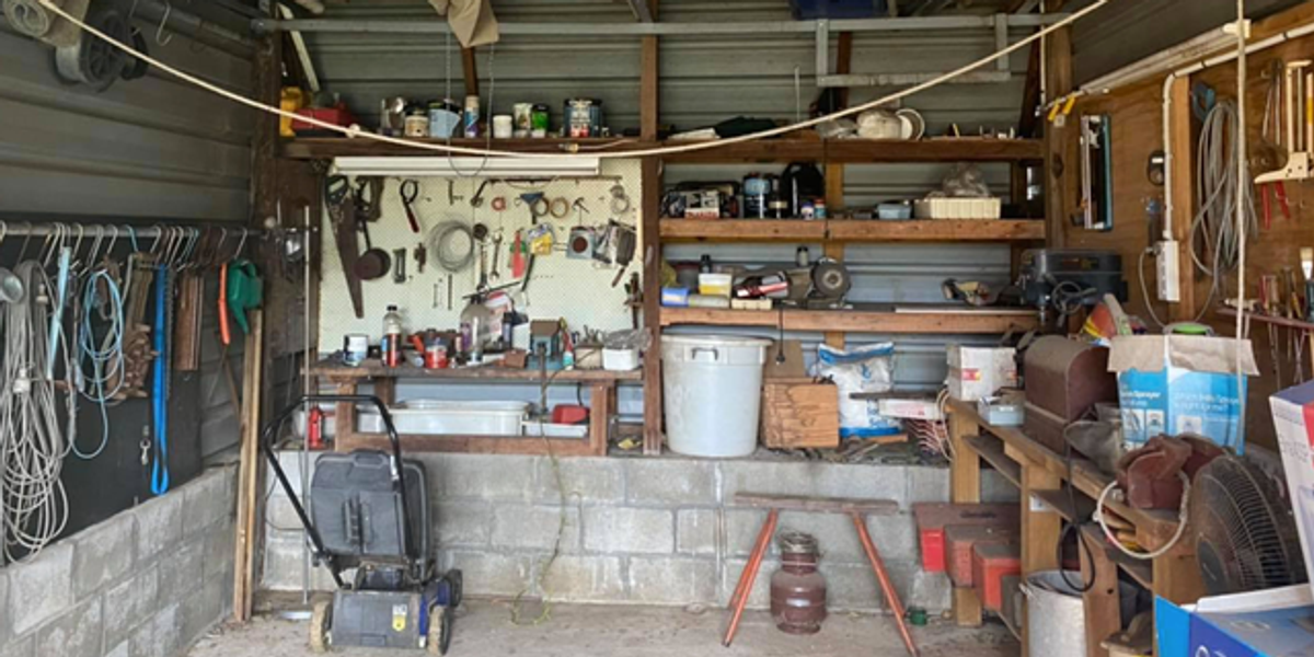 People Are Losing Their Minds Trying To Find The Snake Hiding in Photo of Cluttered Garage