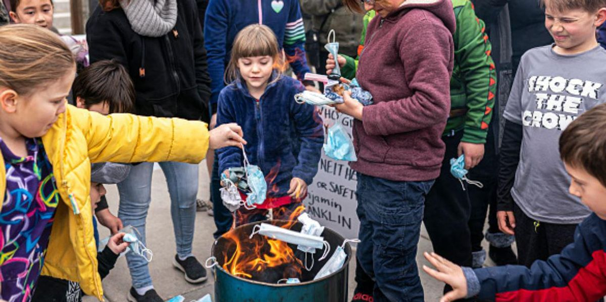 Burn The Mask Rally Sees Kids Throwing Face Masks Into Fire