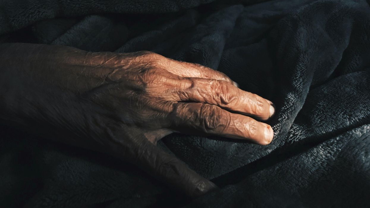 Close up of the hand of an elderly person.