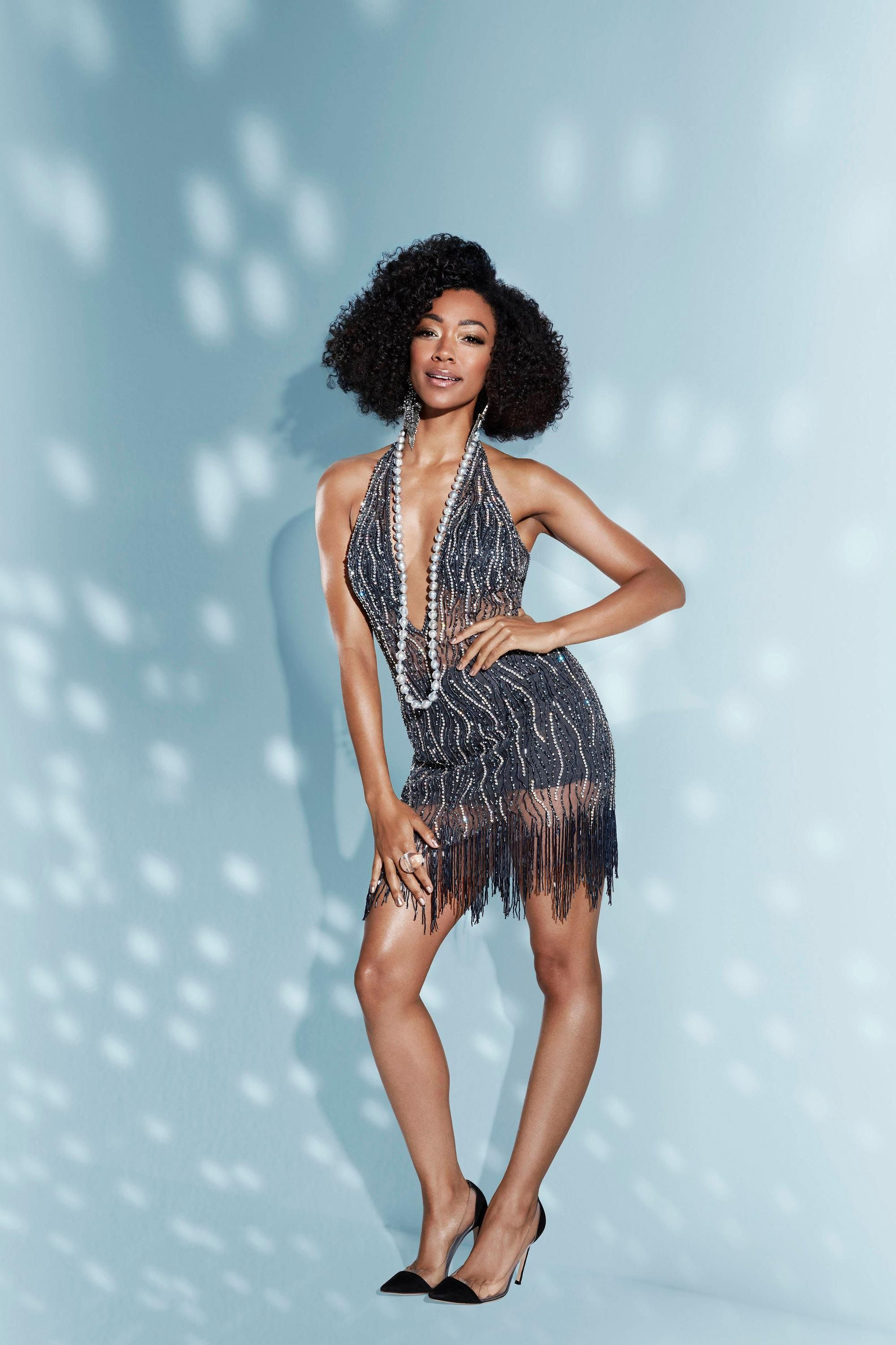 Sonequa Martin-Green in a fringed dress and pearls