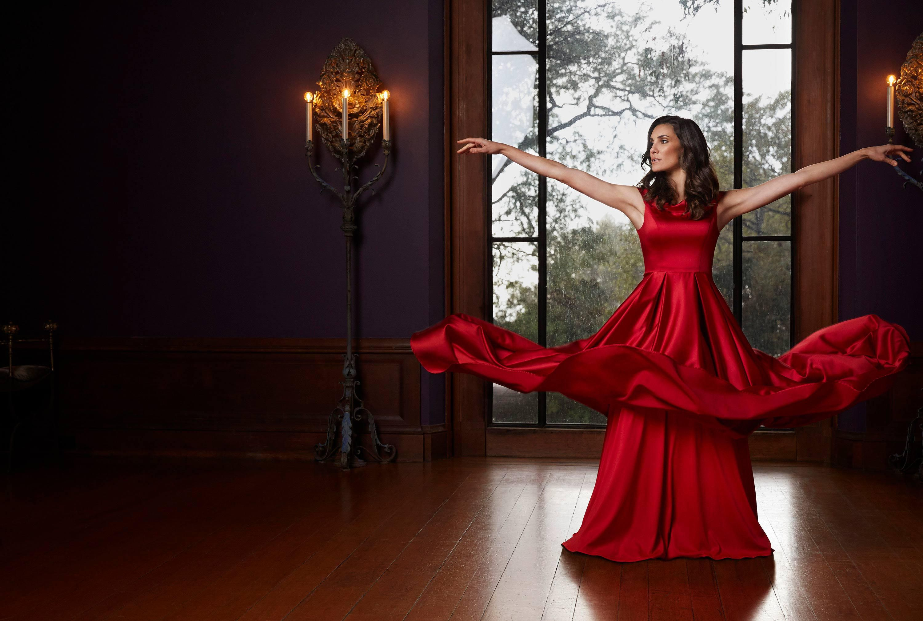 Daniela Ruah in a red gown
