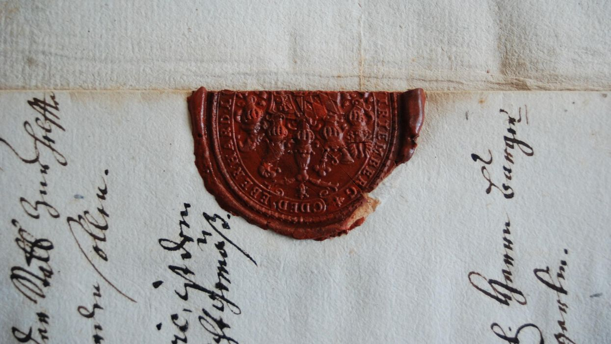 A close up of a letter sealed with wax.